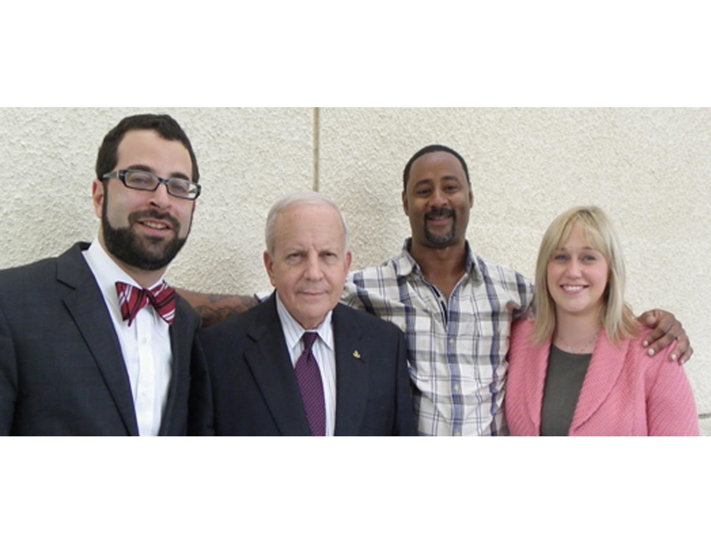 Seth Miller, far left, and Melissa Montle, far right,