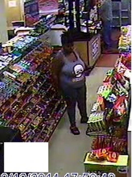 woman suspect accomplice at Mickey Mart in Plymouth
