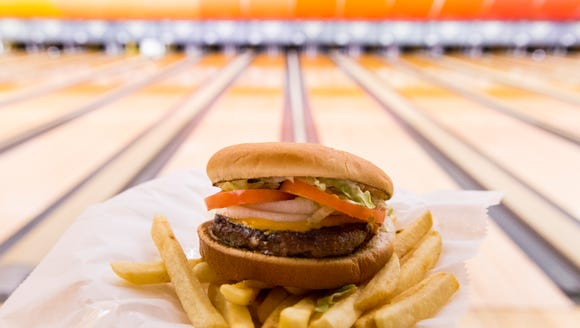 This Advertiser file photo shows the Hebert burger at Acadiana Lanes. This burger is one of the options available for Premier Laser's Tag Your Friends for Lunch promotion.