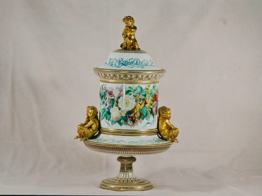 This is how the antique porcelain fruit cooler looked before James Harran of Neptune mailed it to a customer in Ohio.