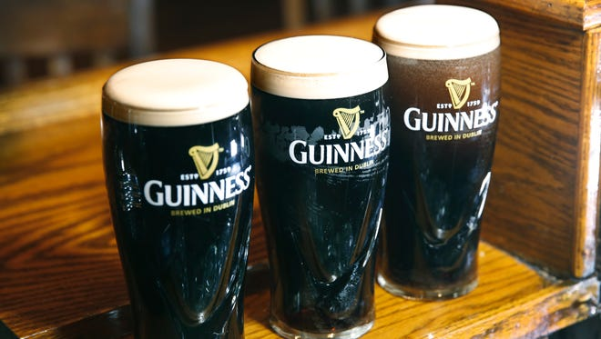 Guinness is served in the iconic wide-mouthed 20-ounce glass at Mulconry's Irish Pub in Fairport.