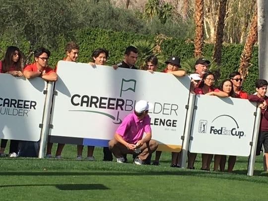Charlie Reiter crouches as his high school teammates