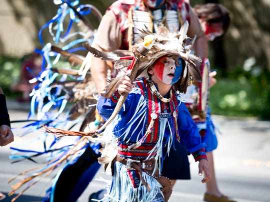 Cordiero Howle, 6, dances in the 4th of July Parade as a part of the Little Shell Pow Wow Committee.