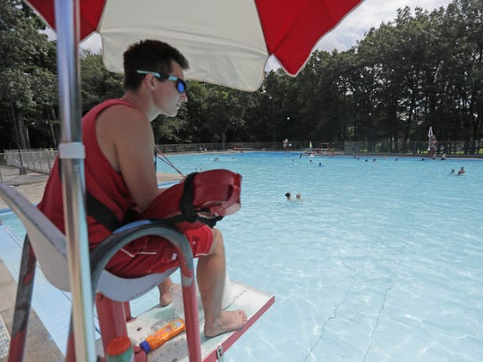 A lifeguard watches swimmers at the Colburn Park pool.