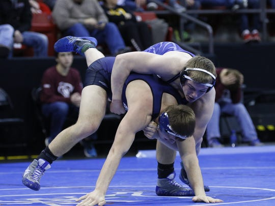 Amherst's Bryce Holderman, top, has made it to state in each of the past two seasons, claiming third place last year in the 195 weight class. Now wrestling in the 220 class, Holderman owns a 22-1 record this season.