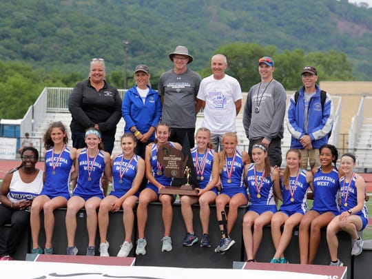 The Waukesha West girls squad poses with the Division 1 first-place team trophy in La Crosse.