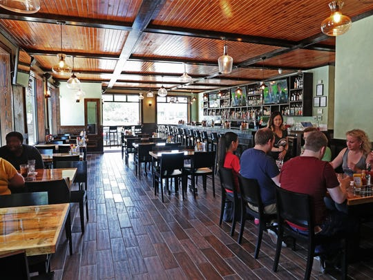 Remodeling freshened and brightened the interior at Oscar's Winner's Circle, with new details that respect the 1910 building.
