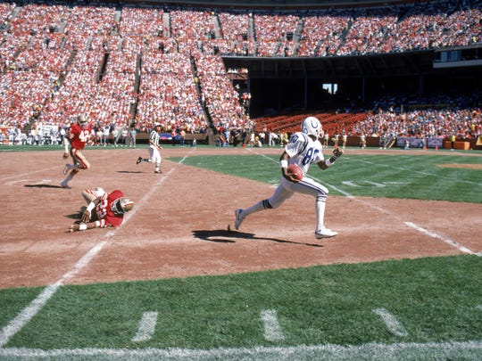 Wide receiver Bill Brooks #80 of the Indianapolis Colts break away from the San Francisco 49ers secondary to score a touchdown during a game at Candlestick Park on October 5, 1986 in San Francisco, California.  The 49ers won 35-14.