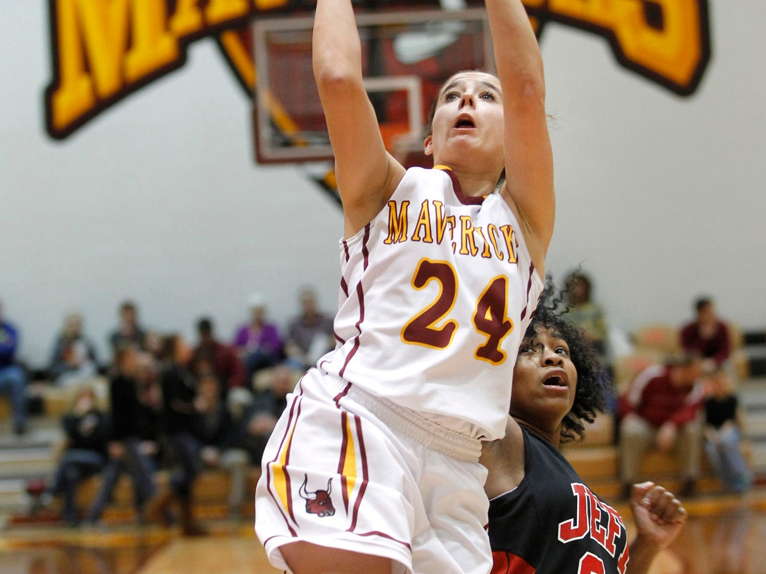 McCutcheon's Kerstyn Lowery gets past Alexia Randolph of Lafayette Jeff for a drive to the basket in girls sectional basketball action Friday, February 13, 2015, at McCutcheon High School. McCutcheon defeated Lafayette Jeff 43-33.