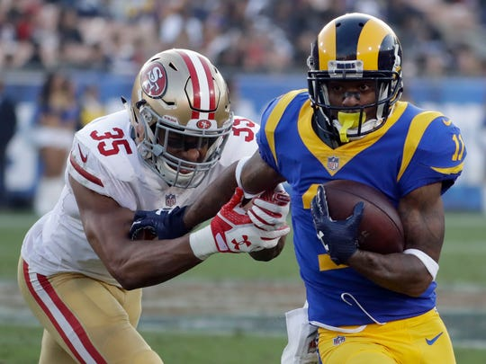Los Angeles Rams wide receiver Tavon Austin, right, breaks away from San Francisco 49ers strong safety Eric Reid during the second half of an NFL football game Sunday, Dec. 31, 2017, in Los Angeles.