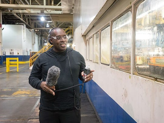 Kevin Saunderson wound his away through most of the plant holding a microphone as presses stamped steel into parts.