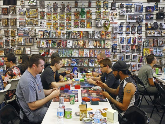 Patrons play card games Sunday, May 24, 2015 at Samurai