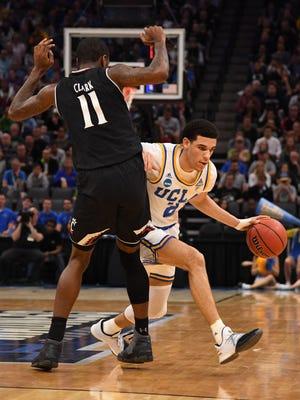 UCLA Bruins guard Lonzo Ball (2) dribbles around Cincinnati Bearcats forward Gary Clark (11) during the second round of the 2017 NCAA Tournament at Golden 1 Center.
