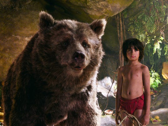 Mowgli (Neel Sethi) and Baloo the bear (voiced by Bill
