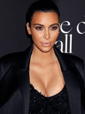 Kim Kardashian's new book collects her selfies.