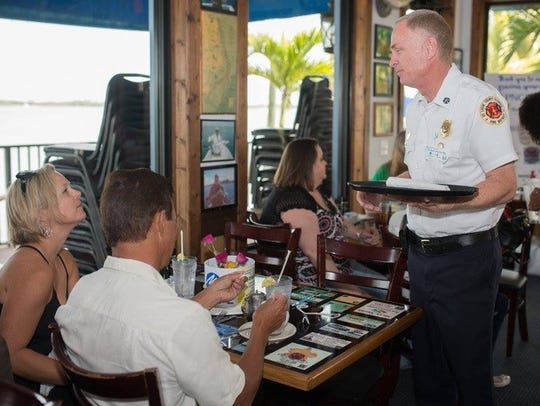 St. Lucie County Fire Chief Buddy Emerson serves guests