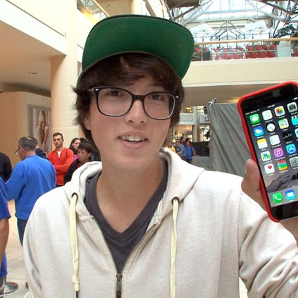 J.P. Kinney, 17, Tinton Falls, holds the iPhone 6 he purchased at the Apple Store in the Freehold Raceway Mall Friday morning.