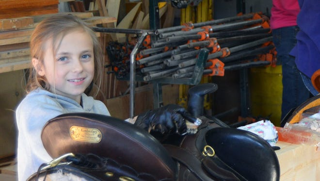Southern Kettle Moraine Horse Trail Association Jr Member, Bailey LeRoy puts a shine back on her saddle during the first annual saddle cleaning party on March 4.