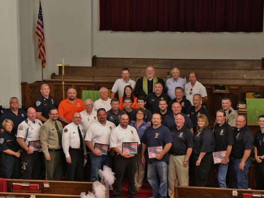 Local first responders gathered for a picture Sunday