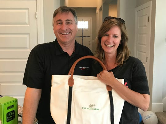 Jack and Judy Dickson were attracted to Durham Farms in part because of the built-in social network offered by the community. They are shown here on their move-in day with gifts from the homeowners association.