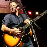 Bruce Springsteen performs at the Stand Up for Heroes event at Madison Square Garden in New York on Nov. 6, 2013. He will headline the March Madness Music Festival in Dallas this weekend.