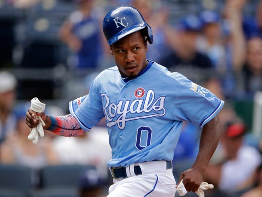 Kansas City Royals' Terrance Gore runs home to score on a bunt-single hit by Adalberto Mondesi during the third inning of a baseball game against the Cleveland Indians, Thursday, July 4, 2019, in Kansas City, Mo. (AP Photo/Charlie Riedel)