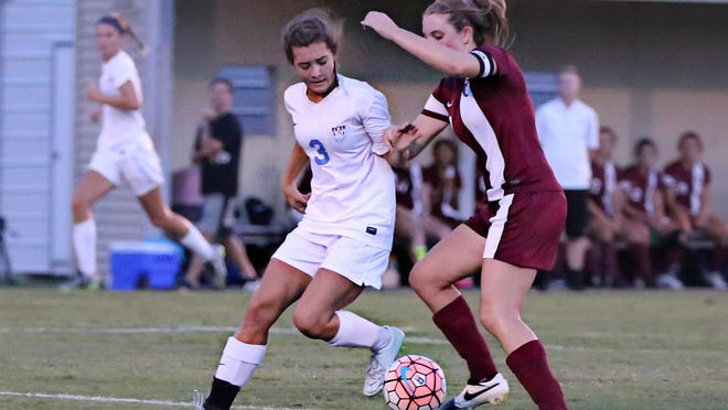 USJ's Sophie Stallings fights for the ball against a St. George's player on Thursday.