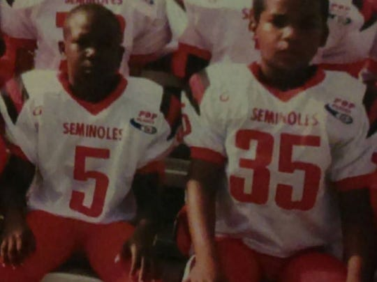 Nine-year-olds Fred Green, left, and Malcom Jackson as members of the Immokalee Seminoles' Pop Warner team in 2008. The two longtime friends are now vital cogs on the undefeated Immokalee High School football team in 2017