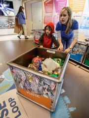 Recycling Specialist Kelly Mehring teaches five-year-old Fitz Bingen of Minnesota about the recycling process during the Earth Week Finale event at Retzer Nature Center in Waukesha on Saturday, April 28, 2018.