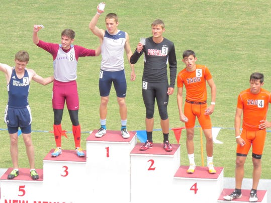 Silver's Brandon Chavez stand on top of the podium after winning the Class 4A state title in the 400-meter dash in Albuquerque.