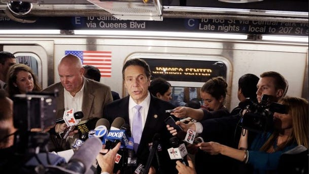 Gov. Andrew Cuomo holds a news conference on a subway platform, Thursday, Sept. 25, 2014 in New York.