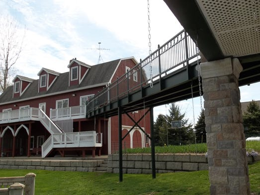 An elevated walkway connects an outbuilding to the