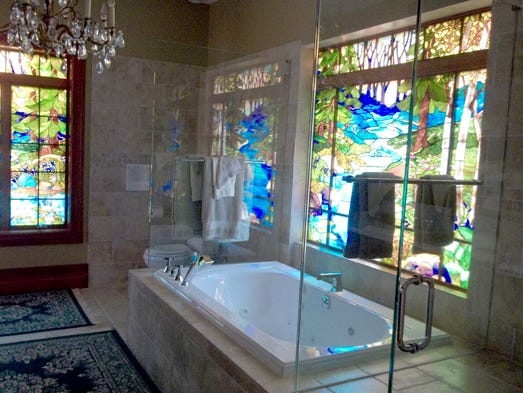 One of the bathrooms features stained glass windows.