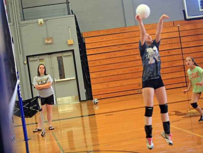 Nanuet girls volleyball coach Jen Adams, left, watches her players during practice Aug. 27, 2014.  (Carucha L. Meuse / The Journal News)