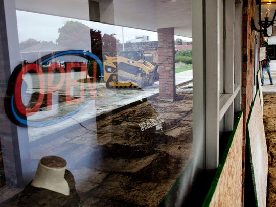 Some businesses are closed as concrete is removed as part of courtyard renovations Thursday at St. Clair Riverview Plaza.
