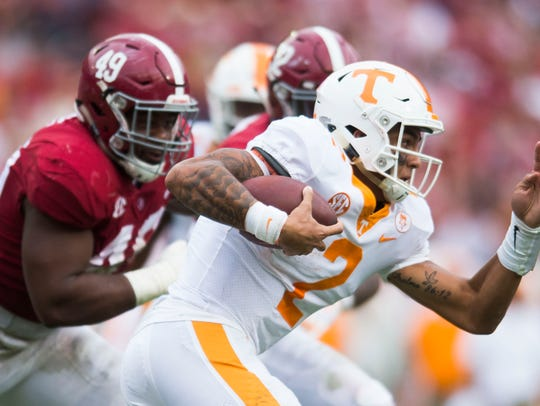 Tennessee quarterback Jarrett Guarantano (2) runs with
