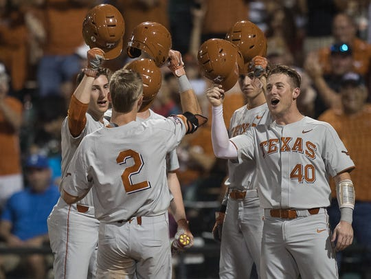 Texas' Kody Clemens celebrates at home plate with his