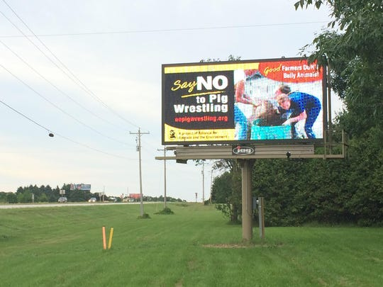 The Alliance for Animals and the Environment bought space on this electronic billboard on Wisconsin 42/57 south of Sturgeon Bay asking for the Valmy Thresheree mud pig wrestling event to be canceled. The ad has since been removed.