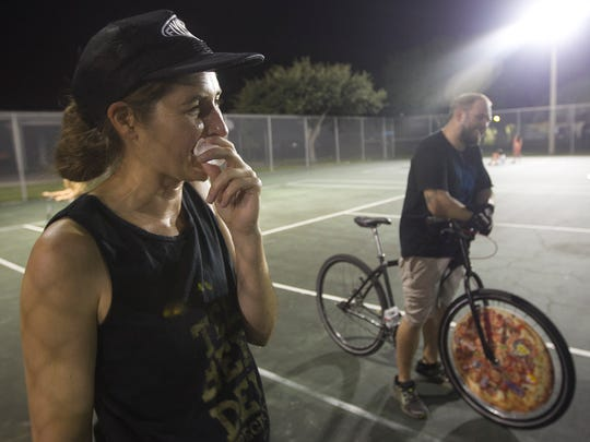 Bike polo player Joelle Hammes ices her lip after getting