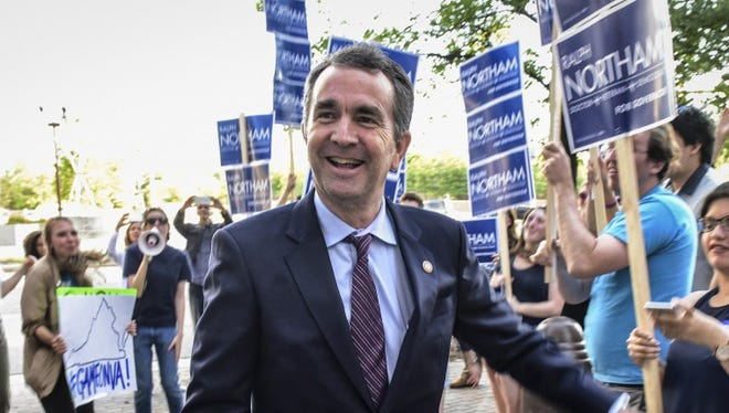 Virginia Lt. Gov. Ralph Northam greets supporters before a debate. MUST CREDIT: Washington Post photo by Bill O'Leary.