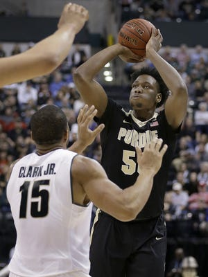 Boilermakers forward Caleb Swanigan (50) shoots over Michigan State forward Marvin Clark Jr. (15) during the Big Ten title game at Bankers Life Fieldhouse on Sunday.