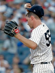 New York Yankees starting pitcher Sonny Gray adjusts his cap after giving up a grand slam to the Boston Red Sox during the first inning of a baseball game, Saturday, June 30, 2018, in New York.
