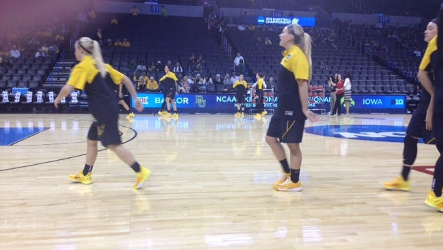 Melissa Dixon (center) and the Iowa Hawkeyes warm up prior to their game against Baylor.