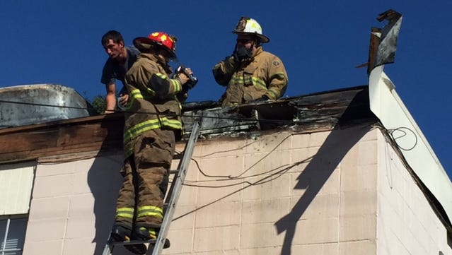 Scott firefighters work an accidental fire at the Westgate Arms apartments Sunday morning.