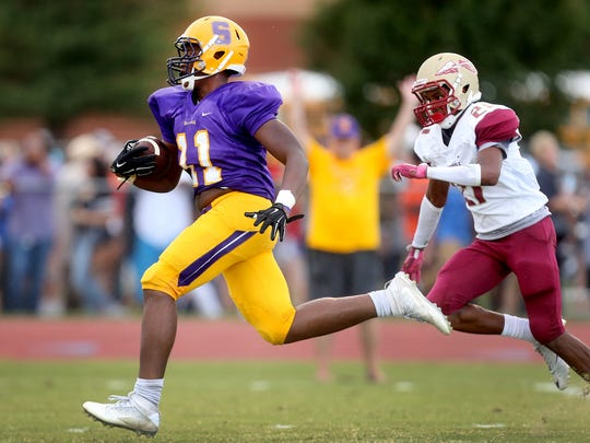 Smyrna's Nick Okeke (11) runs the ball down the field for a touchdown as Riverdale's Caleb Harney(21) tries to catch up during the first Jamboree game of the night at Blackman on Friday, Aug. 12, 2016.