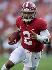 Alabama quarterback Jalen Hurts (2) scores a touchdown