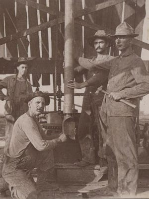 A crew poses for a photo at Anse la Butte in St. Martin Parish.