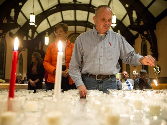 Danny Doolin, of Evansville, lights a votive candle during an interfaith service for World AIDS Day at St. Lucas United Church of Christ in Evansville, Thursday, Dec. 1. 2016. World AIDS Day started in 1988 and falls on Dec. 1, annually.
