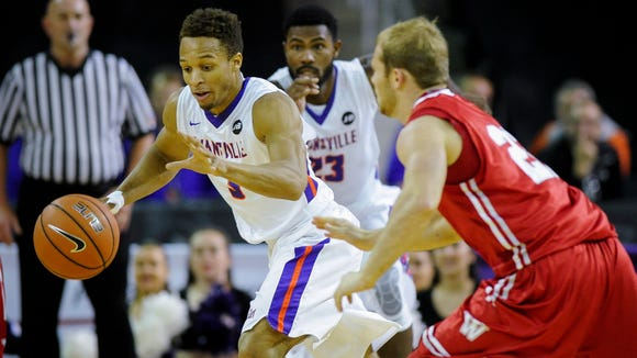 Evansville guard Jaylon Brown (3) steals the ball from  Wabash guard CJ McMann (22) during their game at the Ford Center in Evansville, Wednesday, Nov. 30, 2016.
