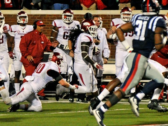 Arkansas running back Alex Collins picks up a lateral and runs for a first down on fourth-and-25 in overtime. Arkansas scored a touchdown and won with the two-point conversion.